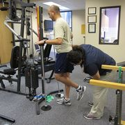 Leg, Room, Human leg, Shoulder, Shoe, Joint, Standing, Physical fitness, Exercise machine, Elbow,