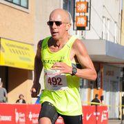 Sports uniform, Endurance sports, Active shorts, Sportswear, Running, Sleeveless shirt, Sunglasses, Goggles, Shorts, Athlete,