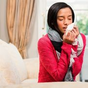 woman blowing bloody nose