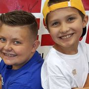 boy sells babseball cards to help friend with cancer
