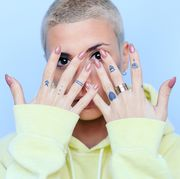 woman with tattooed hands showing off manicure