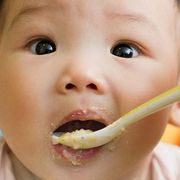 baby eating gerber cereal