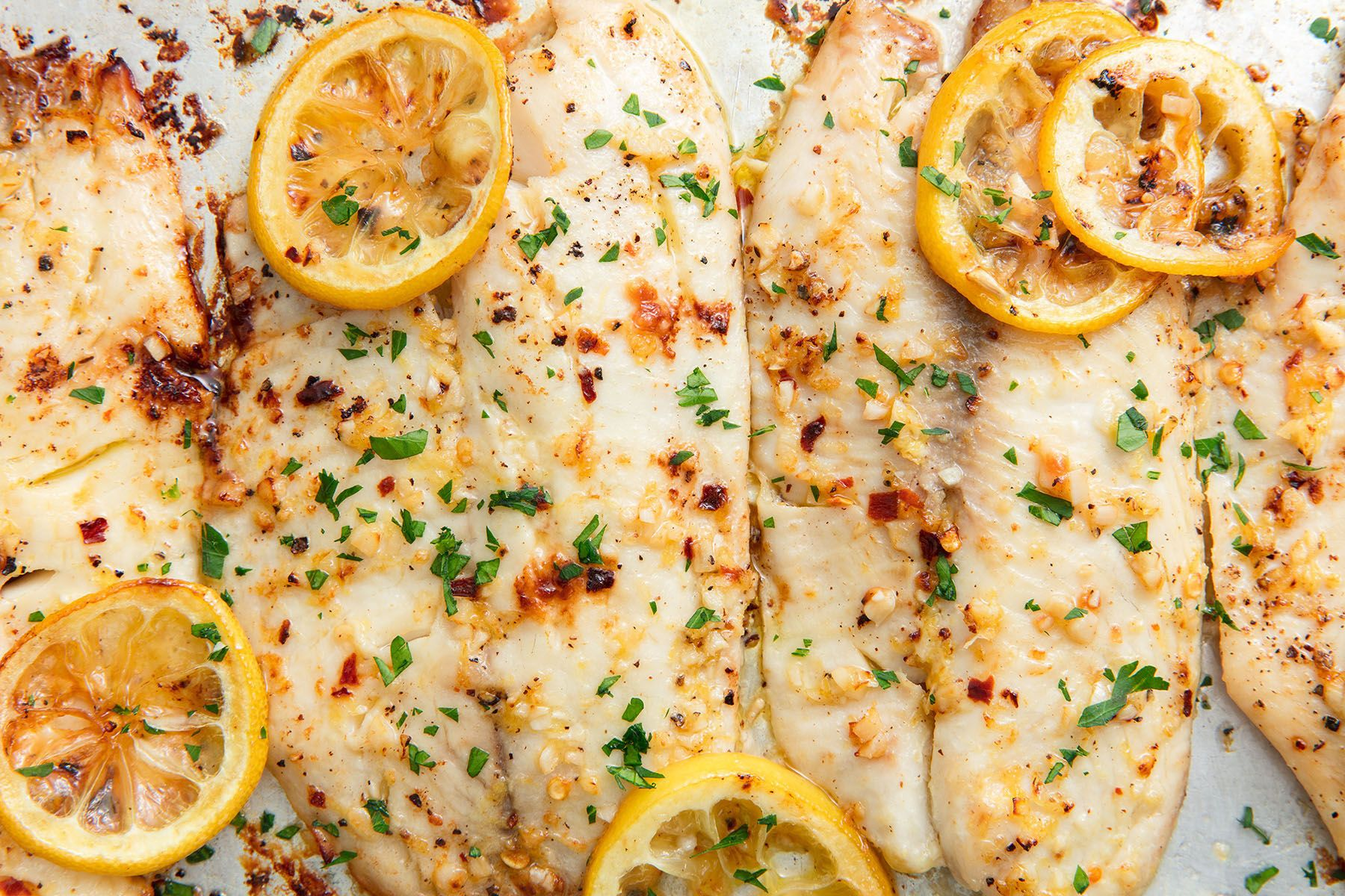 Best Oven Baked Tilapia Recipe How To Bake Lemon Garlic Tilapia