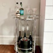 silver circle bar cart in bedroom