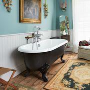 blue bathroom with black tub and shelf