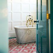 bathroom with green door and floor tiles