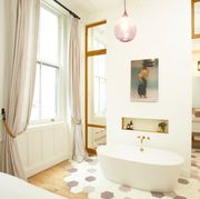 bedroom with bathtub in it