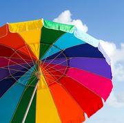 rainbow beach umbrellas against blue sky