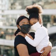 during the covid 19 pandemic a mother and daughter wear face masks