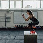 Beautiful woman doing box squats at the gym