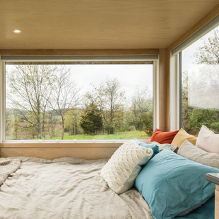 bed in the glass home