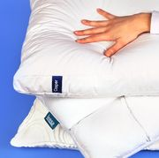 best tested hand pressing down on bed pillows