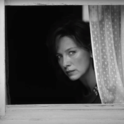 catriona balfe looking out of a window in belfast