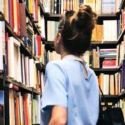 woman browsing in bookstore