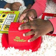 kids playing thinkfun bingo