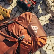Gregory outdoor backpack with hiking shoes and first aid kit