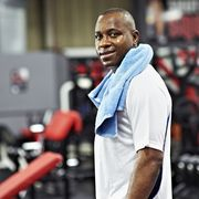 black male standing in local gym