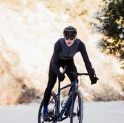 a young man cycling in the winter