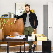 man in black jacket in a home office