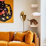 cat tree with orange sofa
