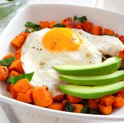 breakfast bowl close up with sweet potato, egg, avocado and spinach