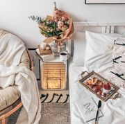 Room, Furniture, Table, Interior design, Living room, Nightstand, Textile, Coffee table, Chair, Peach,