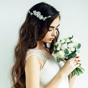 Petal, Hairstyle, Photograph, Bridal accessory, Flower, Hair accessory, Bouquet, Headpiece, Bridal clothing, Dress,