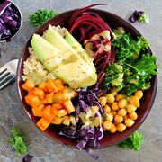 Buddha bowl on a stone background. Healthy eating, overhead scene.