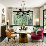 Living room with oval table with gold accents and doors leading outside