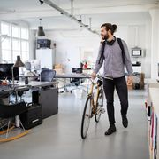businessman with a bicycle in office