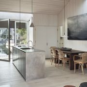 house boat, kitchen and dining room, wooden dining table, wooden dining chairs, concrete kitchen island