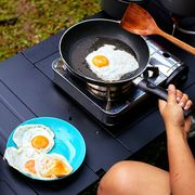 cooking eggs on camping kitchen