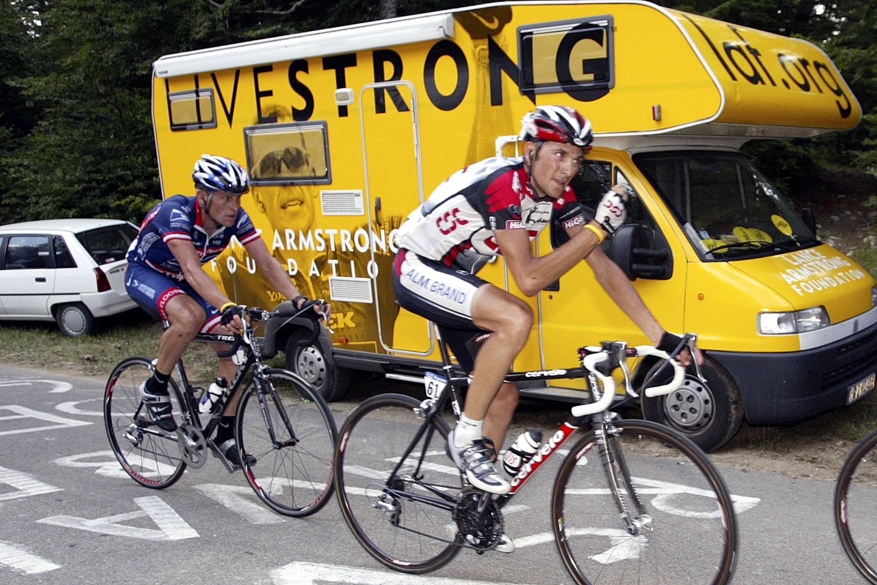 Caption_ Lance Armstrong riding past Livestrong van Credit_ Elizabeth Kreutz.JPG