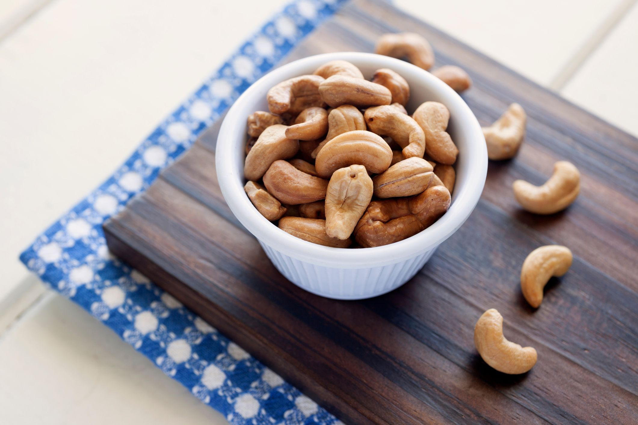 Close-Up Of Cashews In Bowl On Cutting Board