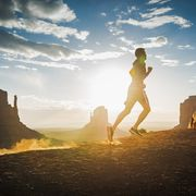 Caucasian man running in Monument Valley, Utah, United States