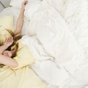 Caucasian teenage girl sleeping in bed