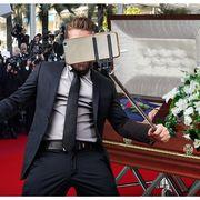 Selfie in front of open casket