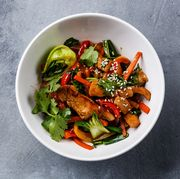 Chicken meat with vegetable in bowl stir fry on wok