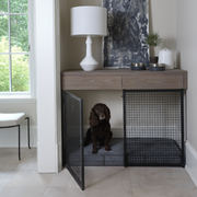 built in dog crate with a dog in it