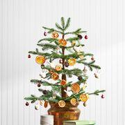 mini christmas tree with dried orange ornaments