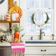 window in kitchen decorated for holidays