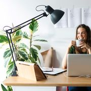 woman working at desk with clip on lamp