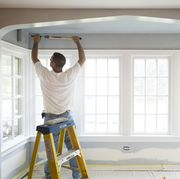 Contractor Painting a Room in HOuse