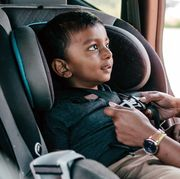 mom buckling kid into convertible car seat