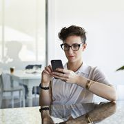 Cool businesswoman scrolling on phone