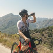 cyclist drinking from water bottle