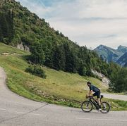 cyclist on hairpin bend on col de corbier