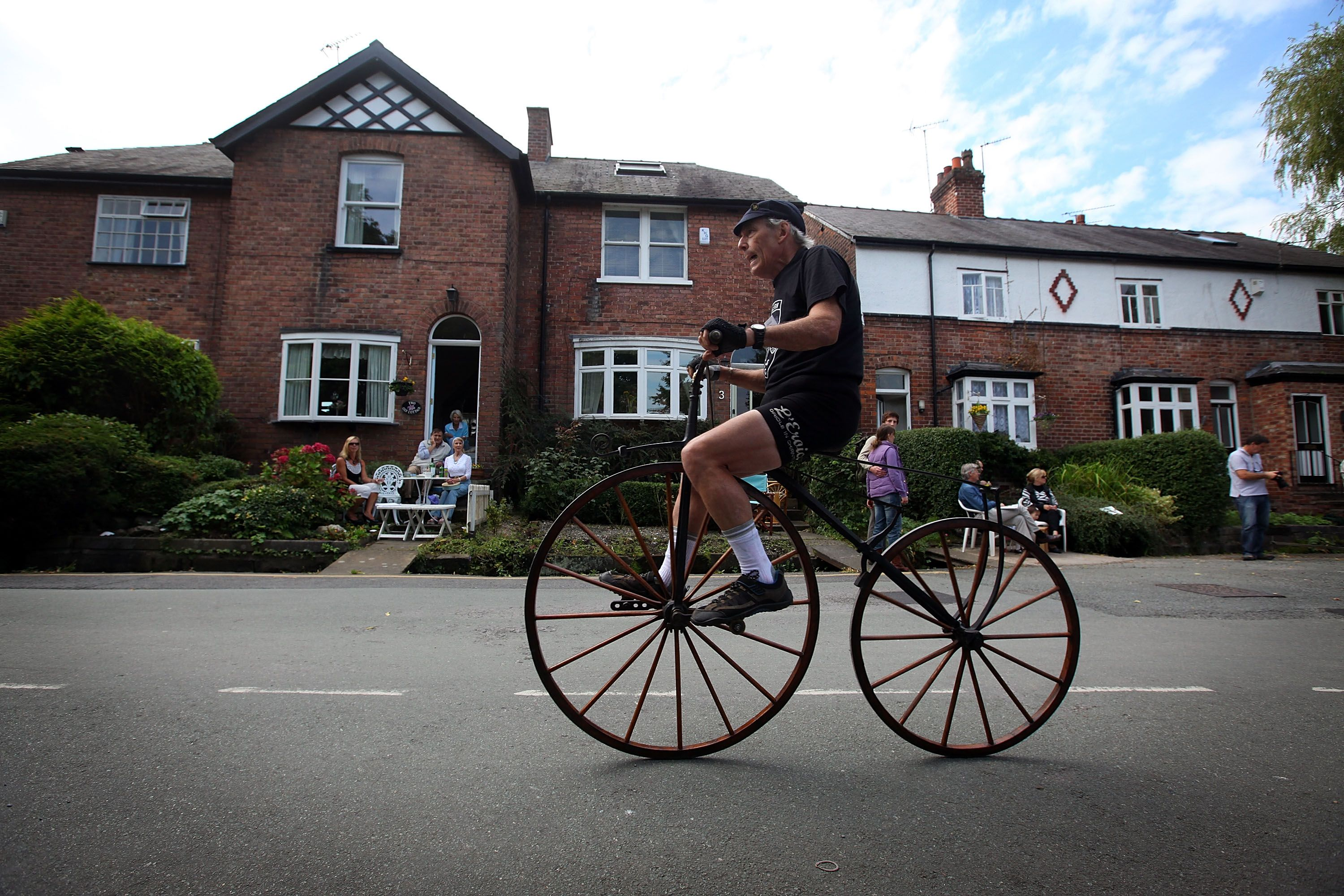 A cyclist takes part in a warmup race riding his bone shaker before the Great Knutsford Penny Farthing Race on September 5, 2010 in Knutsford, England. Original and replica cycles race around the moor and is only held once every 10 years. Competitors have to complete as many laps of the one kilometer course as many times as they can in the three hour time limit.