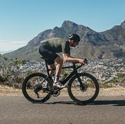 cyclist with cape town's table mountain behind