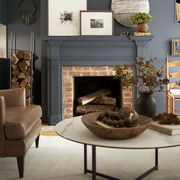 Living room, Furniture, Room, Interior design, Fireplace, Hearth, Property, Table, Wall, Home,